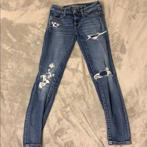 Size 0 Mid rise American Eagle ripped skinny jean